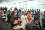 Audience members listen to the new Athletic Director Julie Cromer speak at a press conference at Peden Stadium.