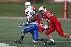 19 October 2013:  Alex Donnelly gets after Shakir Bell during an NCAA football game between the Indiana State Sycamores and the Illinois State Redbirds at Hancock Stadium in Normal IL