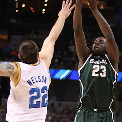 Mar 17, 2011; Tampa, FL, USA; Michigan State Spartans forward Draymond Green (23) shoots over UCLA Bruins forward Reeves Nelson (22) during the first half of the second round of the 2011 NCAA men's basketball tournament at the St. Pete Times Forum.  Mandatory Credit: Derick E. Hingle