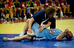 Gorazd Zuzek and injured Vid Kavticnik of Slovenia during the Men's Handball European Championship Main Round match between Slovenia and Czech republic at the Olympia Hall on January 24, 2009 in Innsbruck, Austria.  (Photo by Vid Ponikvar / Sportida) - on January 2010