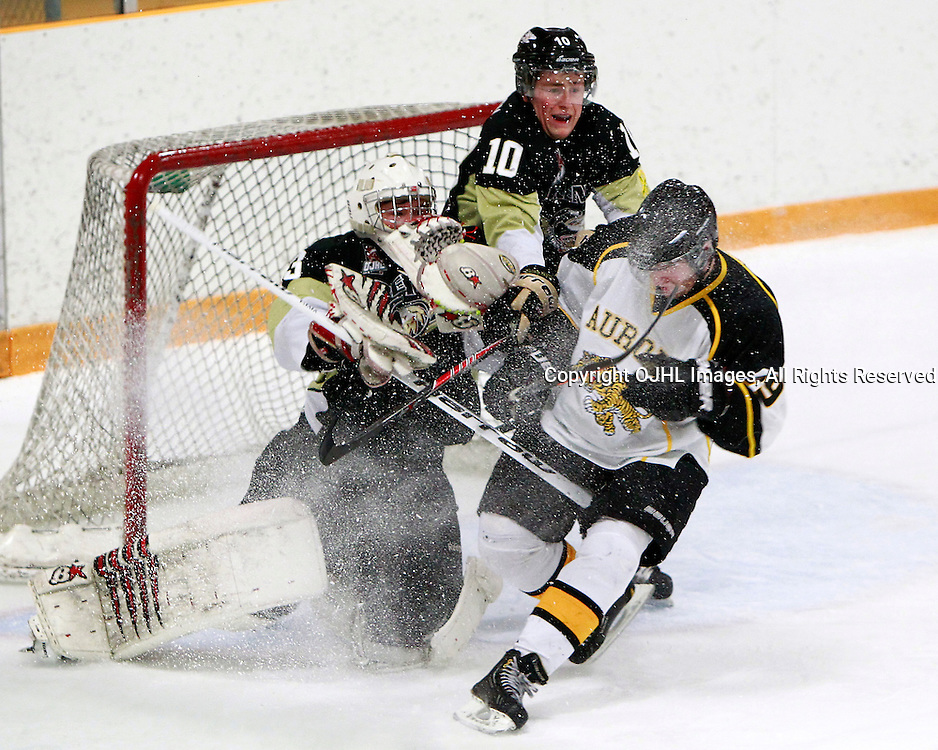 AURORA, ON - Dec 14 : Ontario Junior Hockey League Game Action between the Trenton Golden Hawks and the Aurora Tigers, Adam DiBrina #29 of the Aurora Tigers Hockey Club makes the hit on Denny Dubblestyne #33 of the Trenton Golden Hawks Hockey Club during first period game action.<br /> (Photo by Brian Watts / OJHL Images)