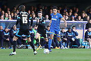 Lyle Taylor forward for AFC Wimbledon (33) advances on thePortsmouth defence during the Sky Bet League 2 match between AFC Wimbledon and Portsmouth at the Cherry Red Records Stadium, Kingston, England on 26 April 2016. Photo by Stuart Butcher.