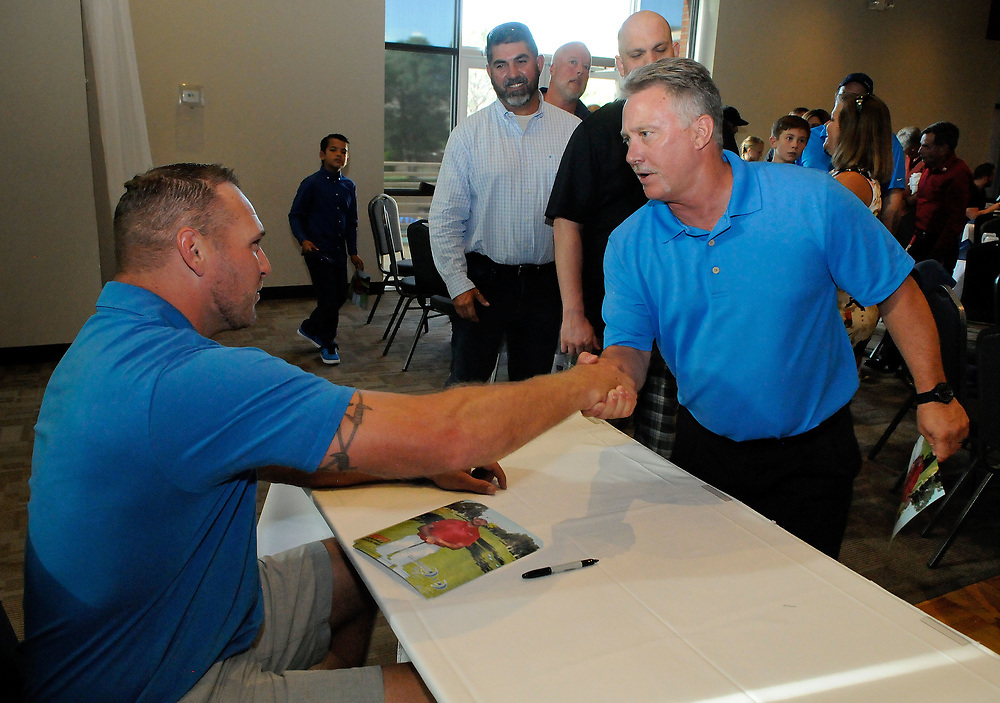jt072617f/ sports/jim thompson/  Tony Pomroy shakes hands with Brian Urlacher after getting his autograph at the VIP mixer following the Brian Urlacher Golf Tournament the the Canyon Club Golf course. July. 26, 2017. (Jim Thompson/Albuquerque Journal)