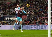 Football - 2018 / 2019 Premier League - Tottenham Hotspur vs. Burnley<br /> <br /> Oliver Skipp (Tottenham FC)  gets above Jack Cork (Burnley FC) to just glance his header wide at Wembley Stadium.<br /> <br /> COLORSPORT/DANIEL BEARHAM