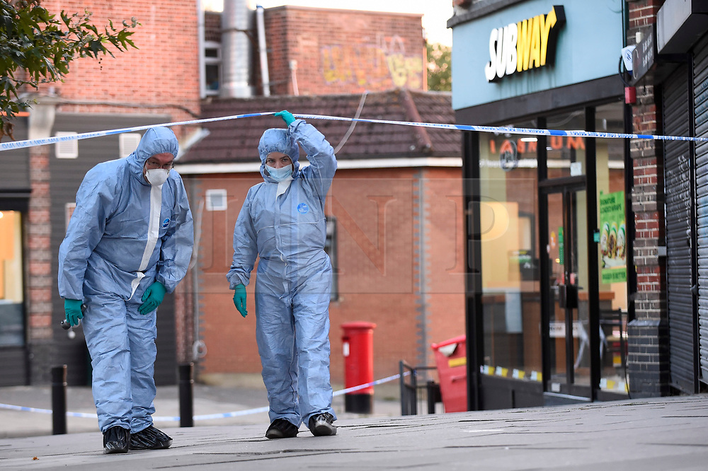 © Licensed to London News Pictures. 21/08/2018. LONDON, UK. Forensics officers work at the scene. A police cordon is set up on Imperial Drive near Rayners Lane tube station, north west London, following a shooting in which two men suffered gunshot wounds.  It is reported that the suspect and accomplice have been.   Investigations are ongoing.  Photo credit: Stephen Chung/LNP