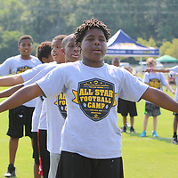 Tristen Jones, 11, warms up Saturday for the All-Star Football Camp benefiting the Boys and Girls Clubs of North Mississippi