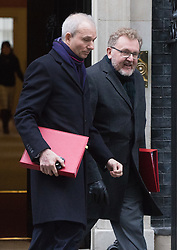 Downing Street, London, January 10th 2017. Leader of the House of Commons David Lidington and Scotland Secretary David Mundell (right) leave the weekly UK cabinet meeting at 10 Downing Street as the new Parliamentary term begins.