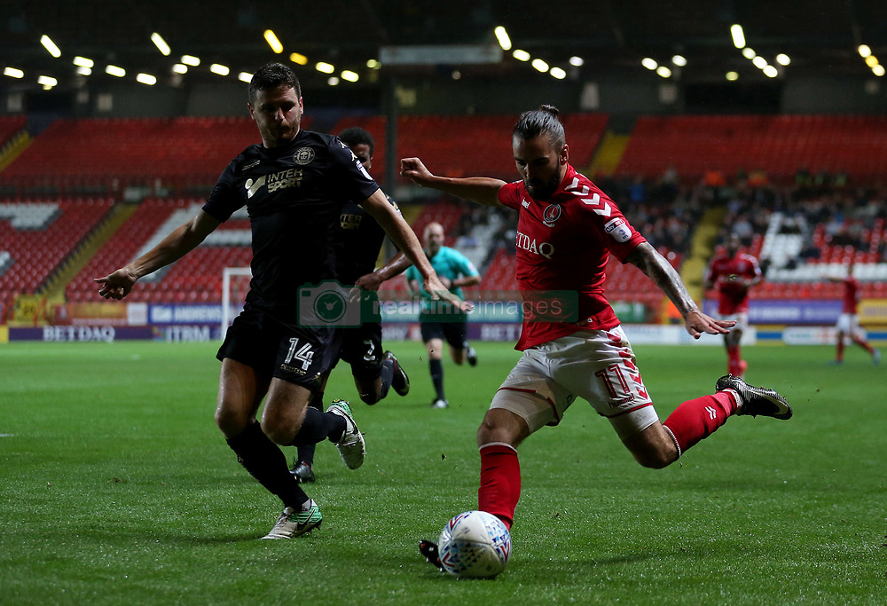 Charlton Athletic's Ricky Holmes and Wigan Athletic's Alex Bruce in action