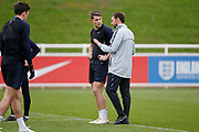 England manager Gareth Southgate chatting to James Tarkowski (Burnley)  during the England training session ahead of the UEFA Euro Qualifier against the Czech Repulbic, at St George's Park National Football Centre, Burton-Upon-Trent, United Kingdom on 19 March 2019.