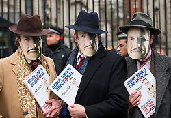© Licensed to London News Pictures. 19/02/2016. London, UK. Leave.EU and the Democracy Movement protestors wearing David Cameron masks, dressed as 'Dodgy Dave' gather outside Downing Street as the Prime Minister David Cameron seeks reform of the United Kingdom's EU membership. Photo credit: Peter Macdiarmid/LNP