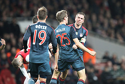 19.02.2014, Emirates Stadion, London, ENG, UEFA CL, FC Arsenal vs FC Bayern Muenchen, Achtelfinale, im Bild l-r: Torjubel von Mario GOETZE #19 (FC Bayern Muenchen), Thomas MUELLER #25 (FC Bayern Muenchen), Philipp LAHM #21 (FC Bayern Muenchen) // during the UEFA Champions League Round of 16 match between FC Arsenal and FC Bayern Munich at the Emirates Stadion in London, Great Britain on 2014/02/19. EXPA Pictures © 2014, PhotoCredit: EXPA/ Eibner-Pressefoto/ Kolbert<br /> <br /> *****ATTENTION - OUT of GER*****