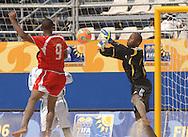 Football-FIFA Beach Soccer World Cup 2006 - Group D-BHR_NGA - Salem-BHR- tries a header against the goal of Abdullahi Isa. - Rio de Janeiro - Brazil 06/11/2006<br />Mandatory credit: FIFA/ Marco Antonio Rezende.