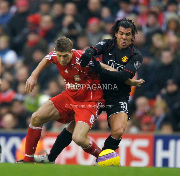 LIVERPOOL, ENGLAND - Sunday, December 16, 2007: Liverpool's captain Steven Gerrard MBE and Manchester United's Carlos Tevez during the Premiership match at Anfield. (Photo by David Rawcliffe/Propaganda)