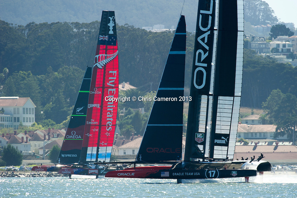 Emirates Team New Zealand chase Oracle Team USA down the final run in race 16 on day 13 of America's Cup 34. 23/9/2013