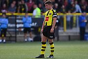 Josh Falkingham of Harrogate Town (4) looks on before a corner kick is taken during the Vanarama National League match between Harrogate Town and Solihull Moors at Wetherby Road, Harrogate, United Kingdom on 25 August 2018.