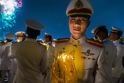 05 DECEMBER 2013 - BANGKOK, THAILAND: A member of the Royal Thai Marines holds a candle during a celebration of birthday of the King. Thais observed the 86th birthday of Bhumibol Adulyadej, the King of Thailand, their revered King on Thursday. They held candlelight services throughout the country. The political protests that have gripped Bangkok were on hold for the day, although protestors did hold their own observances of the holiday. Thousands of people attended the government celebration of the day on Sanam Luang, the large public space next to the Grand Palace in Bangkok.     PHOTO BY JACK KURTZ