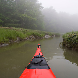 Kayaking a tidal creek in Marquoit Bay, Brunswick, Maine.