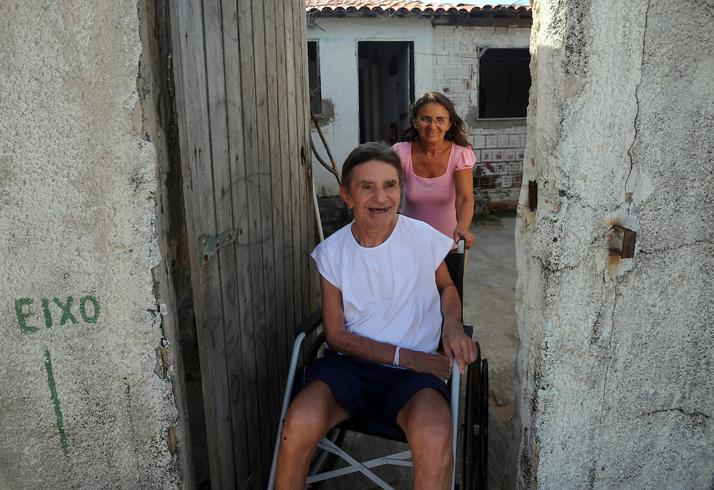 Maria Ines De Nascimento and her brother Jamie Gomez De Nascimento go out for some fresh air. The family have succeeded in retaining their house despite government efforts to knock it down. Fortaleza. Ceasa province, Brazil.