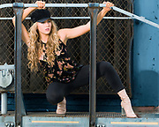 Fashion model Brenna Smith poses on an abandoned locomotive engine by Gerard Harrison Image Theory Photoworks