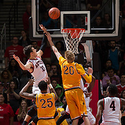 31 January 2017:  The San Diego State Aztecs men's basketball team hosts Wyoming Tuesday night at Viejas Arena. San Diego State forward Max Hoetzel (10) attempts to tip the ball in on a missed shot in the first half. The Aztecs lead the Cowboys 31-27 at half time. www.sdsuaztecphotos.com