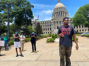 """Today at the Mississippi State Capitol 29 yr old history teacher from Cardozo Middle School ,Dhahran Hall, spoke truth to power and lead  demonstrators in support of Black Lives Matter and the murder of George Floyd and police brutality and systematic racism. Protestors gathered at the State Capitol and marched around downtown Jackson returning to the Capitol they chanted """" Say There Names"""", """" I can't Breathe"""", """" No Justice No Peace"""" """" Justice for George Floyd"""" it was a very peaceful protest and march.  In the past 6 days protests and riots have broken out across America in response to the brutal killing of an unarmed African American man by the knee and hands of Minnesota Police<br /> Officers. Photo copyright © @suzialtman #Suzi Altman #protest#peace #blacklivesmatter #georgefloyd #policebrutality #racism #america #mississippi #peacefulprotest #teachlovenothate, white supremacy, cover-19, corona virus, pandemic"""