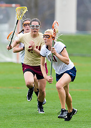 Virginia A Kaitlin Duff (10) runs past Boston College's Lauren Fitzpatrick (24) on a clear.  The #4 ranked Virginia Cavaliers women's lacrosse team defeated the Boston College Eagles 12-4 at the University of Virginia's Klockner Stadium in Charlottesville, VA on April 5,2008.