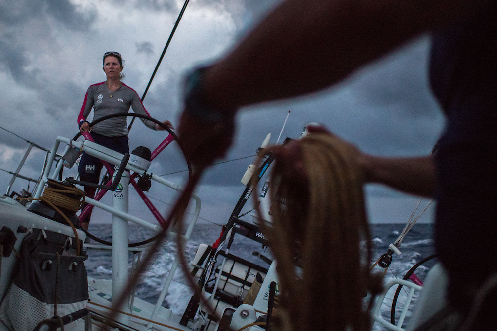 May 3, 2015. Leg 6 to Newport onboard Team SCA. Day 15. Sam Davies helms during a tack and sail change.