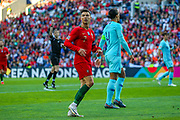 Portugal forward Cristiano Ronaldo (7) looks across at the referees assistant during the UEFA Nations League match between Portugal and Netherlands at Estadio do Dragao, Porto, Portugal on 9 June 2019.