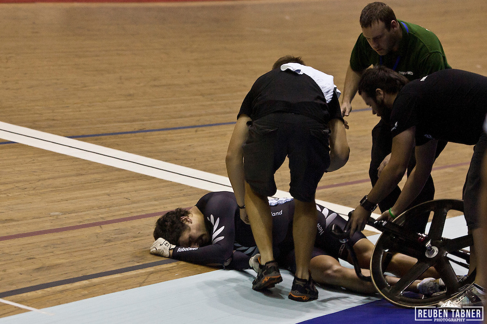 Edward Dawkins from New Zeland collapses on the finish line after a nasty crash on the final bend of the men's Keirin final resulted in a number of injuries. UCI Track Cycling World Cup, Manchester.