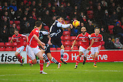 Lee Gregory of Millwall FC tries to get the ball under control, under pressure from Adam Chambers of Walsall FC during the Sky Bet League 1 match between Walsall and Millwall at the Banks's Stadium, Walsall, England on 6 February 2016. Photo by Mike Sheridan.