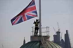 © Licensed to London News Pictures. 18/04/2018. At Somerset House in London to mark Earth Day 2018. A new flag named 'Chloropleth' designed by artist Lauren Bowker of studio The Unseen is raised above Somerset House in London, ahead of an afternoon of free events to mark Earth Day on Sunday 22nd April. The flag changes colour as it reacts in real-time to London's air quality. The iconic colours of the Union Jack will transform, from red, white and blue to smoggy greys and sooty blacks, according to changes in the city's atmosphere, making the invisible visible. Photo credit: Peter Macdiarmid/LNP
