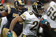 Jacksonville Jaguars running back Fred Taylor (28) rushes up field against St. Louis in the third quarter at the Edward Jones Dome in St. Louis, Missouri, October 30, 2005.  The Rams beat the Jaguars 24-21.