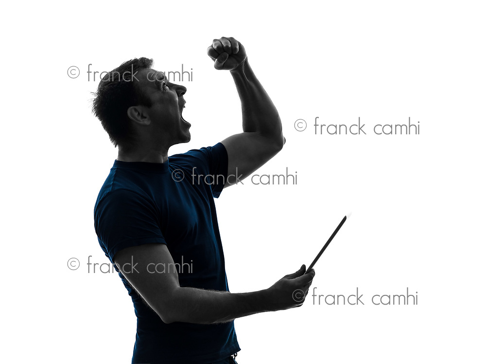 one  man holding digital tablet happy joy in silhouette on white background