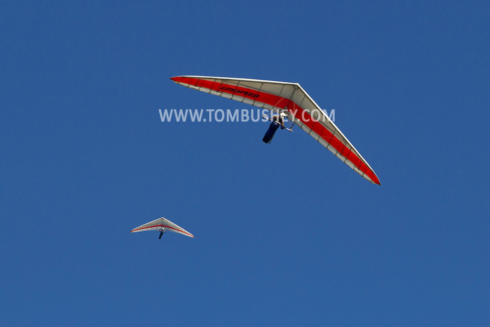 Ellenville, New York - Hang gliders soars in the sky above Ellenville in  a view from the Route 52 overlook on Aug. 8, 2012. ©Tom Bushey / The Image Works