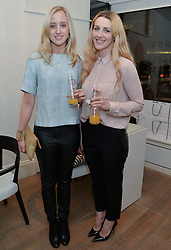 Left to right, CHARLOTTE COX and LAURA GALLACHER at a Valentine's charity event to raise heart awareness and support the charity Arrhythmia Alliance held at Sophie Gass, 4 Ladbroke Grove, London on 13th February 2014.