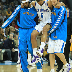 19 January 2009: New Orleans Hornets teammates Melvin Ely (L) and Sean Marks (R) carry Hornets center Tyson Chandler (6) off the court after he injured his ankle on a play in the first half of a NBA regular season game against the Indiana Pacers at the New Orleans Arena in New Orleans, LA. .