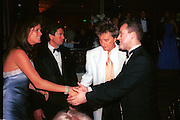 Rachel Hunter, Rod Stewart and Paul Burrell. The Princess Ball. Beverly Wilshire Hotel. Beverly Hills. 21 March 1998. © Copyright Photograph by Dafydd Jones 66 Stockwell Park Rd. London SW9 0DA Tel 020 7733 0108 www.dafjones.com