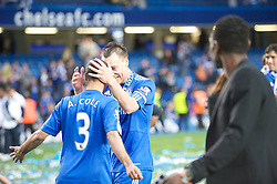 LONDON, ENGLAND - Sunday, May 9, 2010: Chelsea's John Terry and Ashley Cole embrace after winning the 2009/10 Premier League during the final Premiership match of the season at Stamford Bridge. (Pic by Gareth Davies/Propaganda)