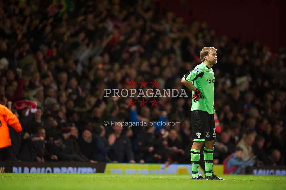 LONDON, ENGLAND - Sunday, December 9, 2012: West Ham United's goalkeeper Jussi Jaaskelainen looks dejected as Liverpool score a winning third goal during the Premiership match at Upton Park. (Pic by David Rawcliffe/Propaganda)