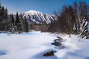 It was a beautiful, albiet very cold, morning on the Carrabassett River with this stunning view of Sugarloaf Mountain.