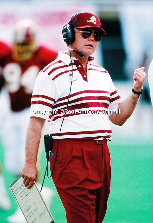 Washington Redskins head coach Joe Gibbs looks on from the sideline during the NFL football game against the Arizona Cardinals on Oct. 4, 1992 in Tempe, Arizona. The Cardinals won the game 27-24. (©Paul Anthony Spinelli)