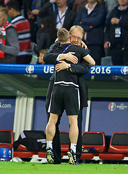 LILLE, FRANCE - Friday, July 1, 2016: Wales' head of international affairs Mark Evans celebrates with masseur Chris Senior after a 3-1 victory over Belgium and reaching the Semi-Final during the UEFA Euro 2016 Championship Quarter-Final match at the Stade Pierre Mauroy. (Pic by David Rawcliffe/Propaganda)