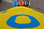 Public recycling receptacles bins and yellow-painted concrete on London's Southbank.