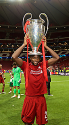 MADRID, SPAIN - SATURDAY, JUNE 1, 2019: Liverpool's goal-scorer Divock Origi with the trophy after the UEFA Champions League Final match between Tottenham Hotspur FC and Liverpool FC at the Estadio Metropolitano. Liverpool won 2-0 to win their sixth European Cup. (Pic by David Rawcliffe/Propaganda)
