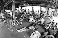 Picture by Andrew Tobin/Tobinators Ltd +44 7710 761829<br /> 04/08/2013<br /> Competitors rest in the shade during the Cycle Messenger World Championships held in Lausanne, Switzerland. Started in 1993 by Achim Beier from Berlin, the championships are not only a sporting contest but an opportunity to unite friends and bicycle enthusiasts worldwide. The event comprises a number of challenges including a sprint, a track stand (longest time stationary on the bike), a cargo race where heavy loads are carried on special bikes, and the main race. The course winds through central Lausanne and includes bridges, stairs, cobbles, narrow alleyways and challenging hills. The main race simulates the job of a bike courier making numerous drops and pickups across the city. Riders need to check in at specific checkpoints, hand over their delivery and get a new one. The main race can take up to 4 hours for each competitor to complete.