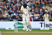 Joe Root of England is tested by a short pitched delivery by Pat Cummins of Australia during the International Test Match 2019, fourth test, day three match between England and Australia at Old Trafford, Manchester, England on 6 September 2019.