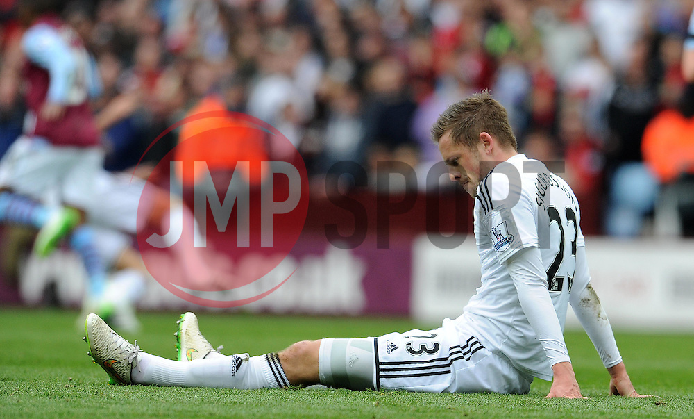 Dejection for Swansea City's Gylfi Sigurosson  - Photo mandatory by-line: Harry Trump/JMP - Mobile: 07966 386802 - 21/03/15 - SPORT - FOOTBALL - Barclays Premier League - Aston Villa v Swansea City - Villa Park, Birmingham, England.