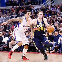 01 February 2014: Utah Jazz shooting guard Gordon Hayward (20) drives past Los Angeles Clippers small forward Matt Barnes (22) during the Los Angeles Clippers 102-87 victory over the Utah Jazz at the Staples Center, Los Angeles, California, USA.