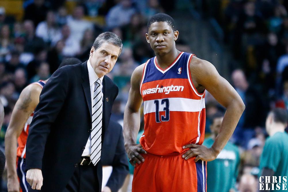 07 April 2013: Washington Wizards head coach Randy Wittman talks to Washington Wizards power forward Kevin Seraphin (13) during the Boston Celtics 107-96 victory over the Washington Wizards at the TD Garden, Boston, Massachusetts, USA.