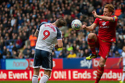 Daryl Murphy of Bolton Wanderers headed effort on goal is blocked during the EFL Sky Bet League 1 match between Bolton Wanderers and Milton Keynes Dons at the University of  Bolton Stadium, Bolton, England on 16 November 2019.